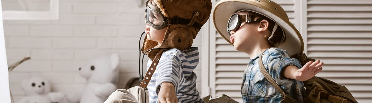 Two-boys-in-the-form-of-an-aircraft-pilot-and-traveler-playing-in-her-room-shutterstock_184331537-2
