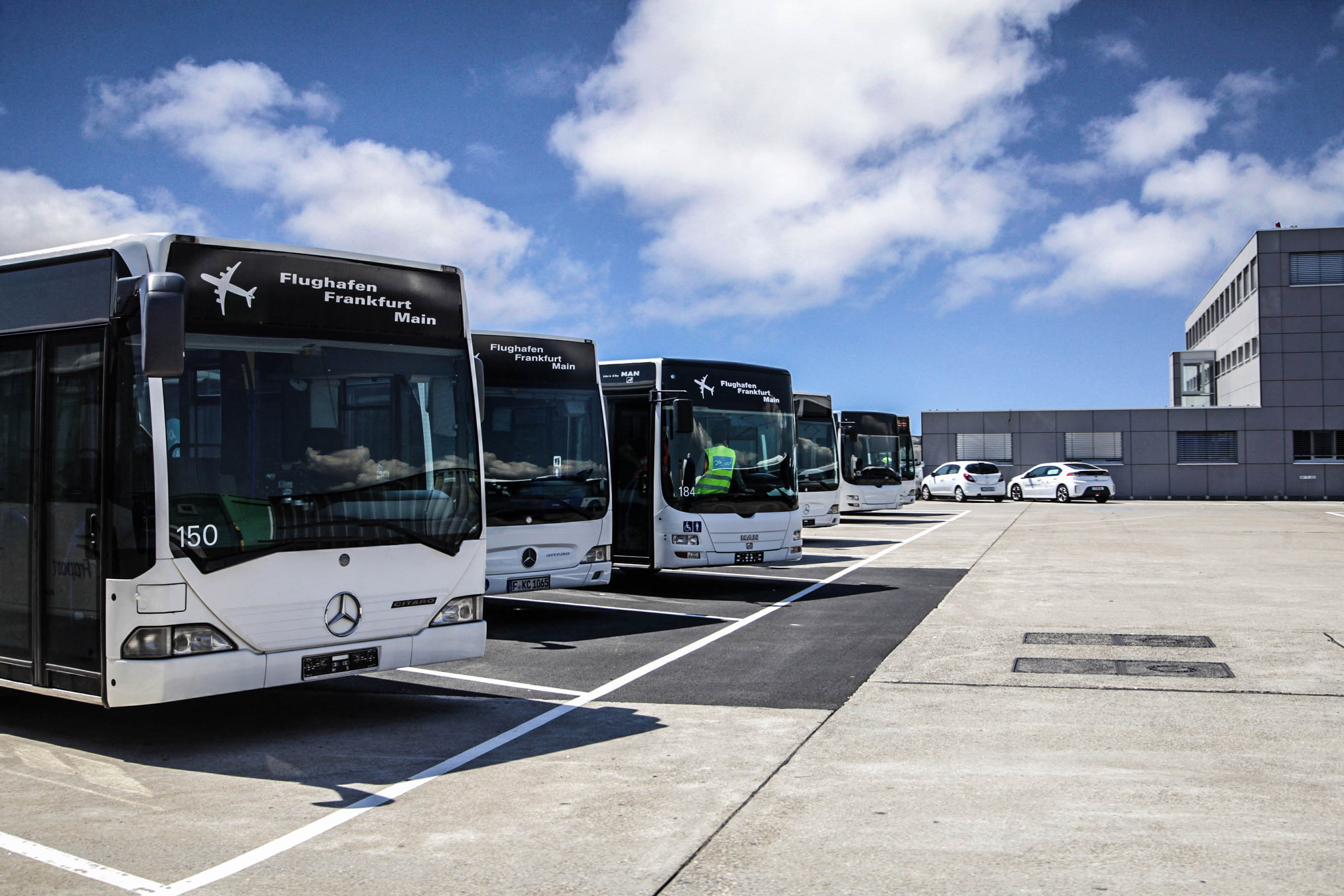 Frankfurt, Germany - August 20, 2015: A row of Mercedes Benz shuttle buses is waiting to be asked to take flight passengers from concorses to external airliner parking positions on the airfield.
