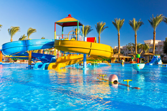"""Palm trees, pool and water slides in luxury tropical resortSee more EGYPT images here:"""