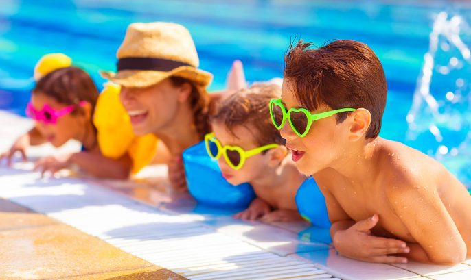 Happy family in the pool shutterstock_153265601-2