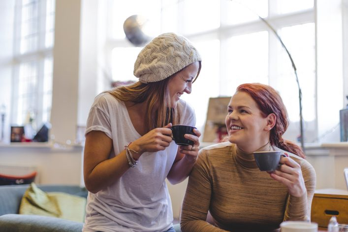 Two Women Chatting in a Coffee Shop