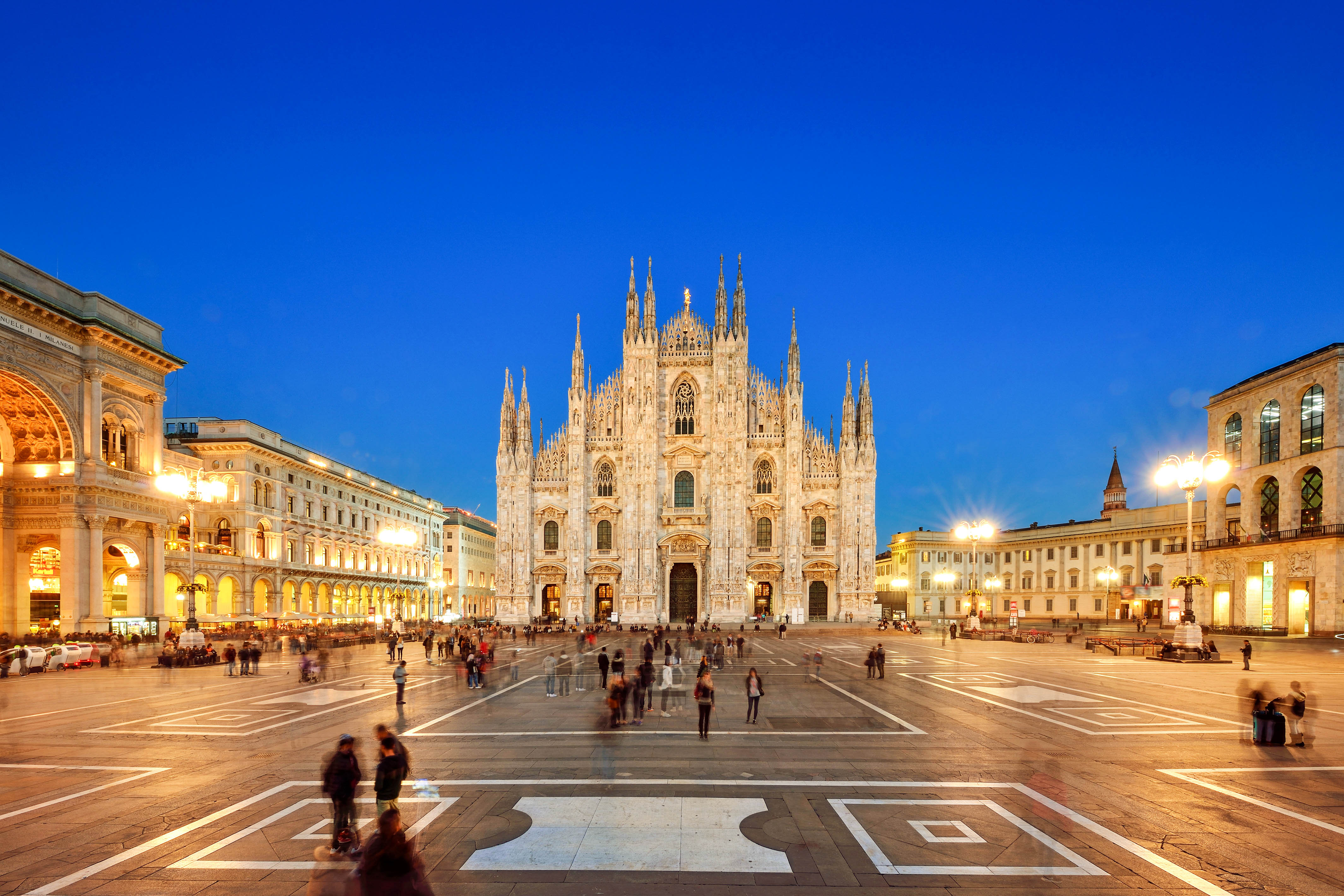 Panoramic Milan Piazza Del Duomo and Vittorio Emanuele Gallery II in blue sky at sunset, Milan, Italy.