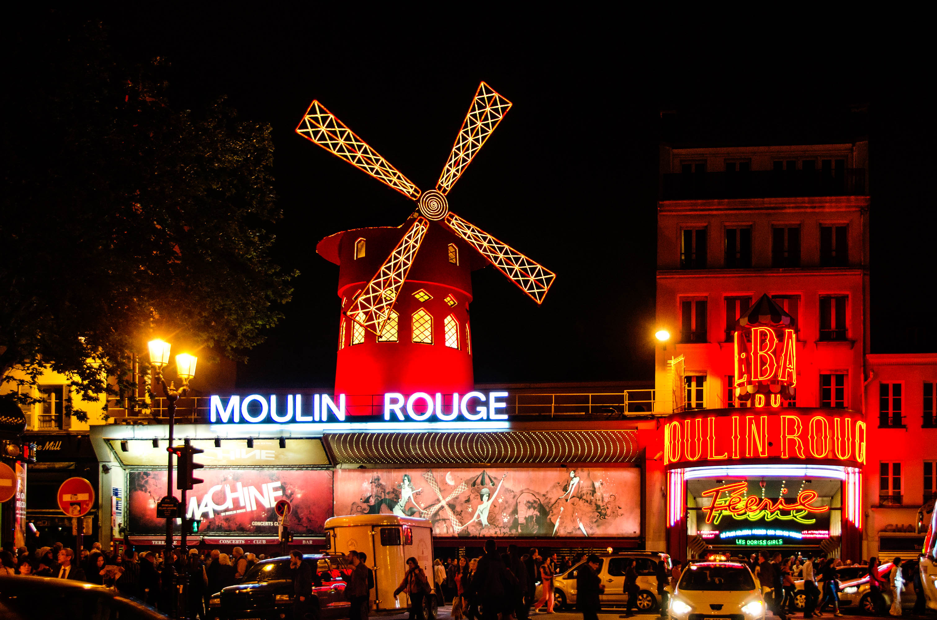 PARIS - APRIL 30: The Moulin Rouge by night, on April 30, 2014 in Paris, France. Moulin Rouge is a famous cabaret built in 1889, locating in the Paris red-light district of Pigalle