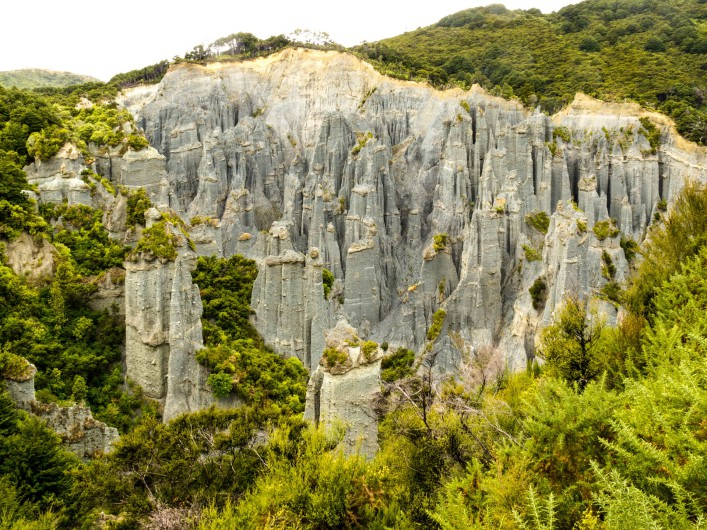 badland-erosion-of-soft-conglomerate-sediment-formations-called-putangirua-pinnacles-shutterstock_103489178-2-707x530