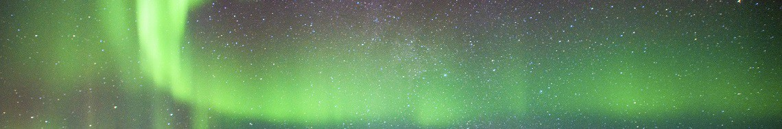 northern-lights-visible-above-small-cabin-in-iceland-istock_000066132119_large