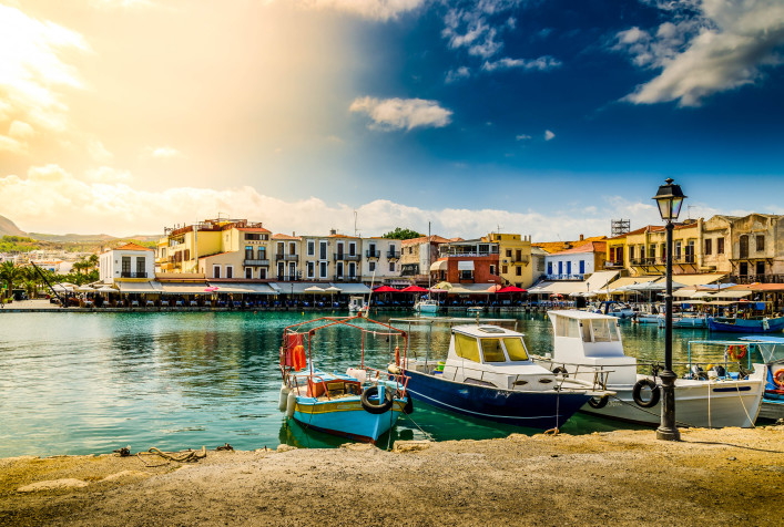 Boats in the old Venetian port of Rethymno on Crete island in Greece