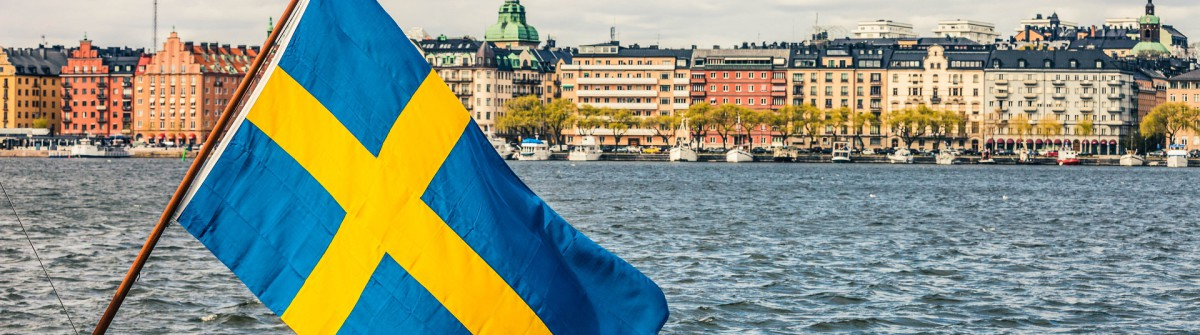 Stockholm view to downtown with a Swedish flag