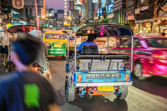 Bangkok, Thailand - March 22, 2016: Tuk-Tuks in downtown China Town. Tuk-Tuks are the typical way to travel fast and cheap within the city limits of Bangkok.