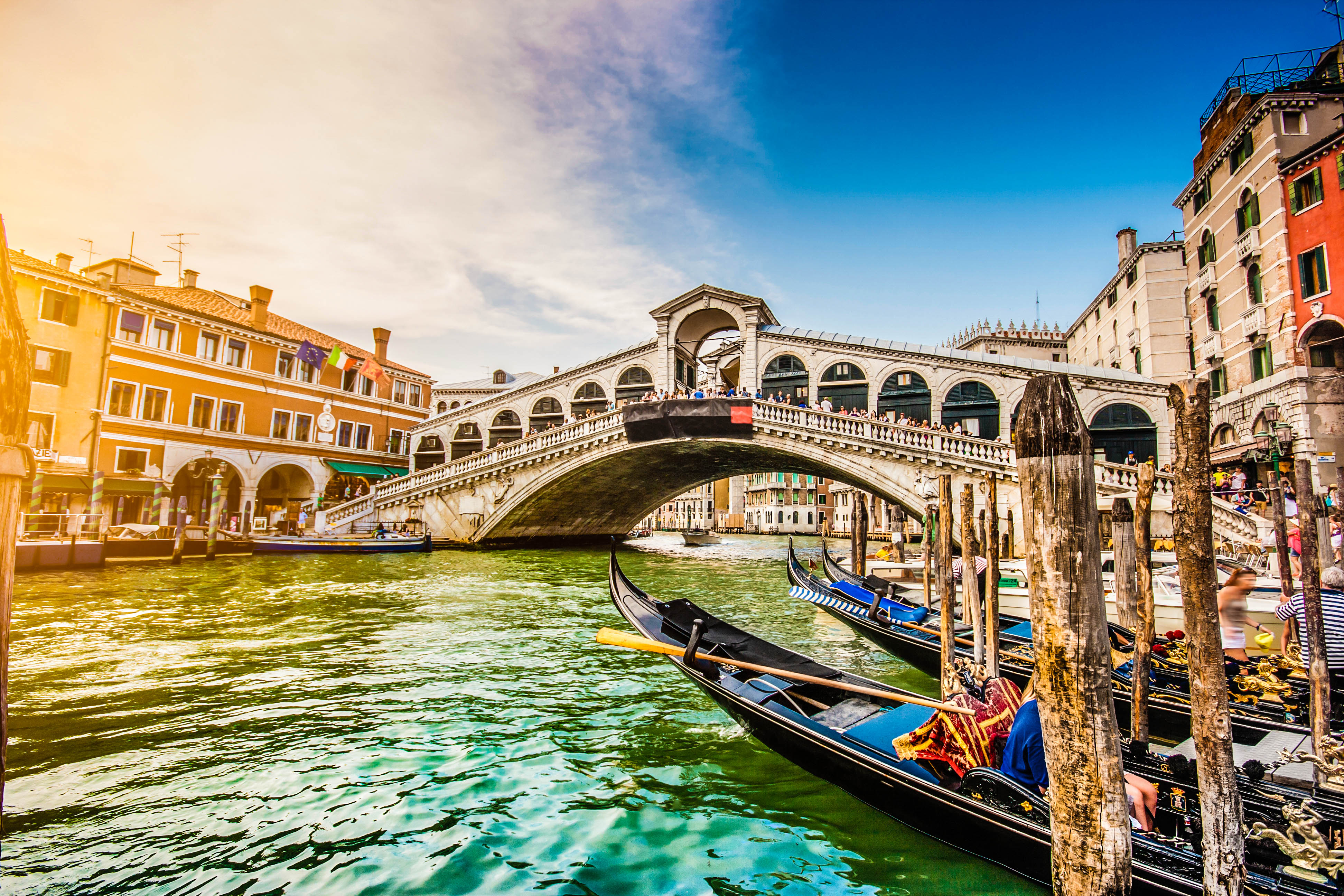 Panoramic view of famous Canal Grande with famous Rialto Bridge at sunset in Venice, Italy with retro vintage Instagram style filter effect