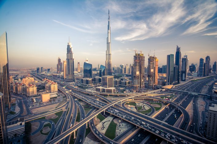 dubai-skyline-with-beautiful-city-close-to-its-busiest-highway-on-traffic_shutterstock_429620146