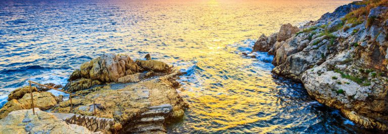 Rocky coastline with magical sunrise,Rovinj,Istria shutterstock_293831582-2