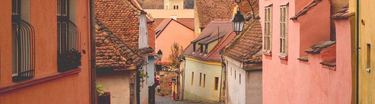 Stone paved old streets with colorful houses in Sighisoara