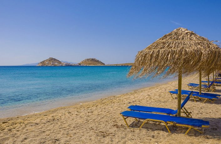 sandy-beach-with-umbrellas-and-sunbeds-blue-found-on-any-island-in-greece-and-europe-shutterstock_53945206-2