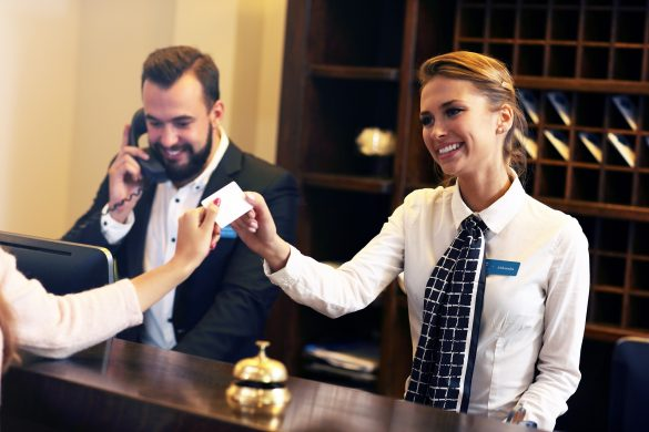 Guests-getting-key-card-in-hotel-iStock-640147624