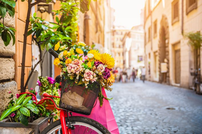 bicycle-with-flowers-in-the-old-street-in-rome-italy-shutterstock_440221486-2