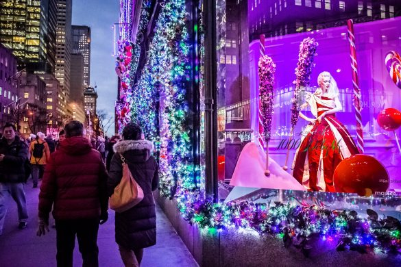 Tourists-and-New-Yorkers-admire-the-holiday-decorations-and-lights-on-Saks-Fifth-Avenue-EDITORIAL-ONLY-Andrew-F.-Kazmierski-shutterstock_686173282