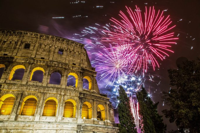 New Year's fireworks in the sky by the Colosseum in Rome