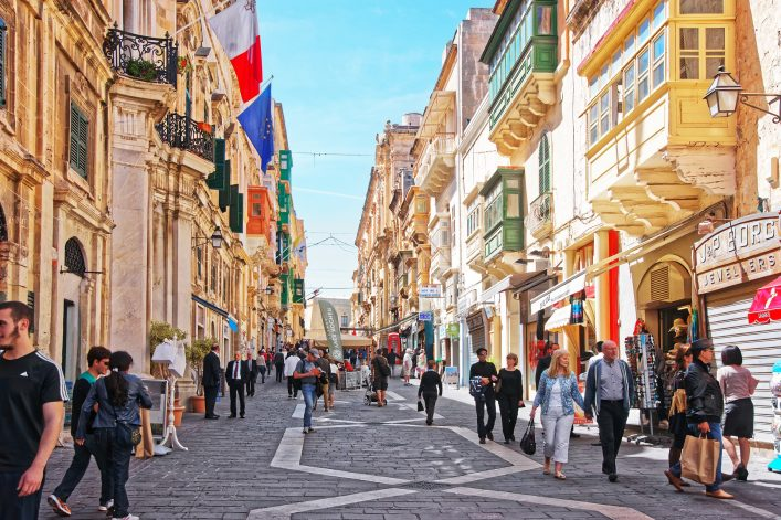 People-on-the-street-full-of-houses-with-traditional-green-balconies-in-Valletta-old-town-Malta_shutterstock_580109746_EDITORIAL-ONLY_Roman-Babakin