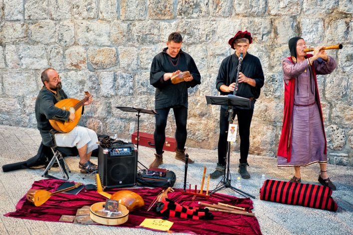 Street musicians in ancient costumes singing and playing in the Old city of Dubrovnik, Croatia EDITORIAL ONLY Roman Babakin shutterstock_657208096