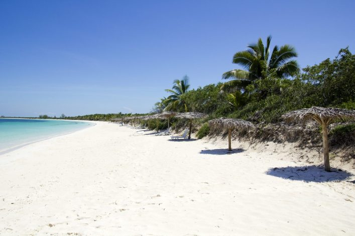 caribbean-beach-in-the-cayo-santa-maria-an-island-surrounded-by-reefs-clear-waters-and-white-sands._shutterstock_98210687-e1547632283543