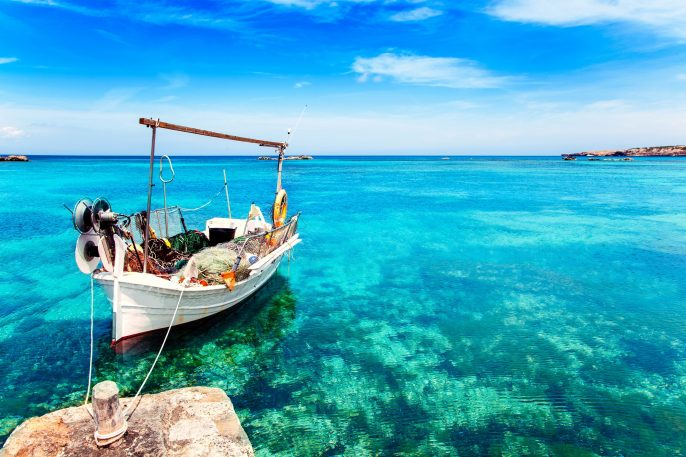 els-pujols-beach-in-formentera-with-traditional-fishing-boat-in-summer-day-shutterstock_107515358-2