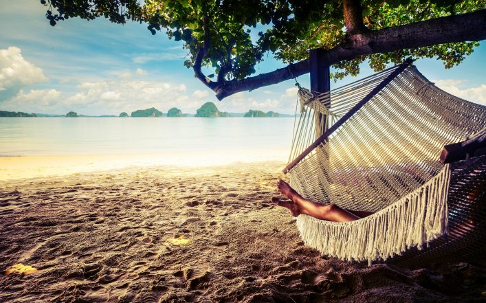 young-lady-relaxing-in-the-hammock-on-the-sandy-beach-with-view-on-remote-tropical-islands-shutterstock_235474936-2-1