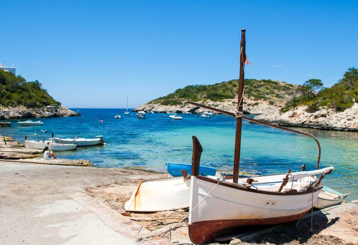 Coastal view of boat at fishermen village on sunny day