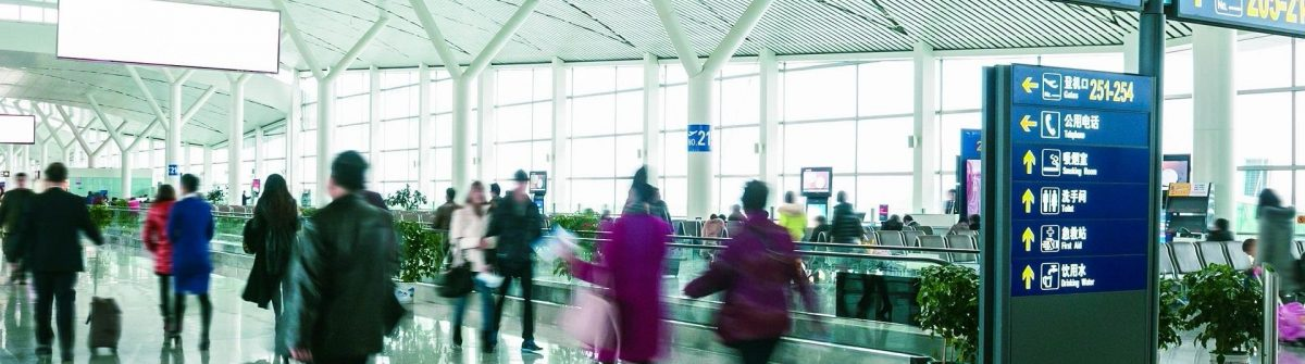 passengers-in-shanghai-pudong-international-airport-airport-shutterstock_129645623-2