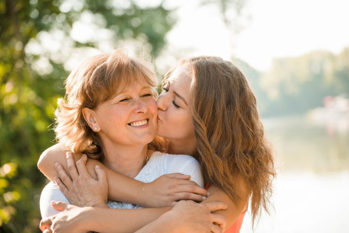 Happy together – mother and teenage daughter outdoor