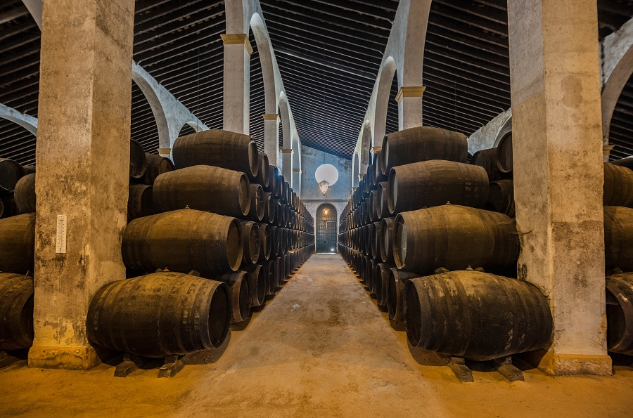 Andalusien;Sherry barrels line a walkway in a bodega in Jerez, Spain