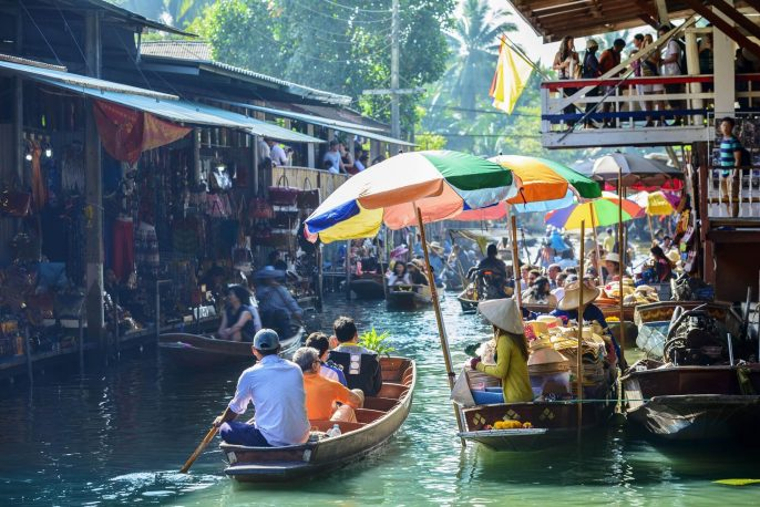 Damnoen-Saduak-Floating-Market-tourists-visiting-by-boat-located-in-Bangkok-Thailand.