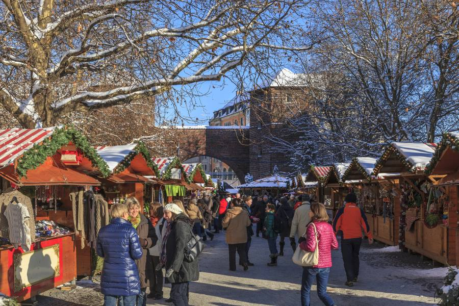 People-at-the-Christkindlmarkt-located-in-Sendlinger-Tor-Platz_EDITORIAL-ONLY_iStock-458594831_900x600_Flavio-Vallenari
