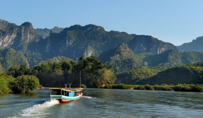 Beautiful-landscape-with-boat-tour-at-Mekong-river-near-Luang-Prabang-in-Laos.-shutterstock_1055902007