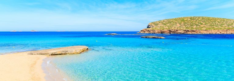Beautiful-sandy-Cala-Comte-beach-with-azure-blue-sea-water-Ibiza-island-Spain-shutterstock_650392843