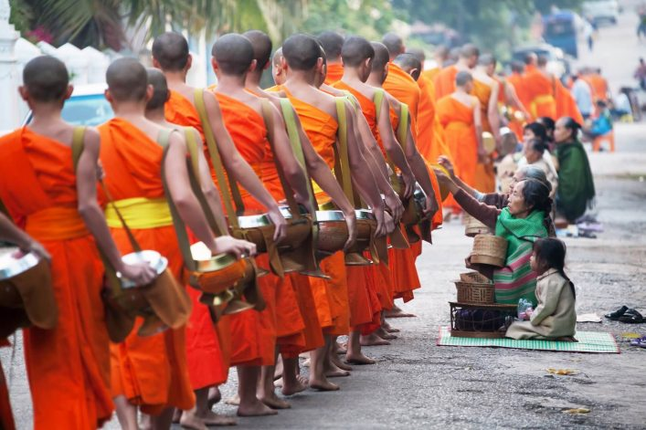 EDITORIAL-ONLY-Kiwisoul.-unidentified-monks-walk-to-collect-alms-and-offerings.-shutterstock_157705136