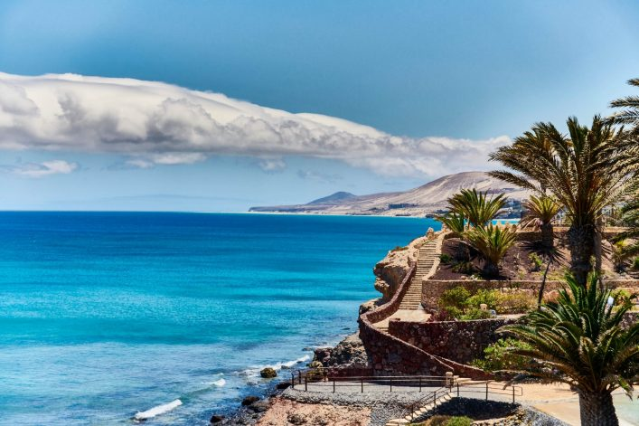 tropical-paradise-with-blue-water-on-island-of-fuerteventura-istock_103993245_xlarge-2-e1554192585181