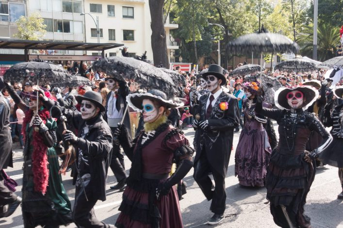 People-Skeleton-Costumes-Day-of-the-Dead-Parade-Mexico-City_iStock-629493958_EDITORIAL-ONLY-SEASTOCK-e1540806565714