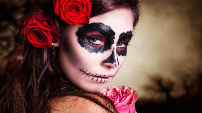attractive-young-woman-with-sugar-skull-makeup-shutterstock_209736142-2