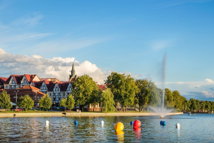 elk-panorama-with-lake-and-fountain-masuria-poland-shutterstock_314771609-2