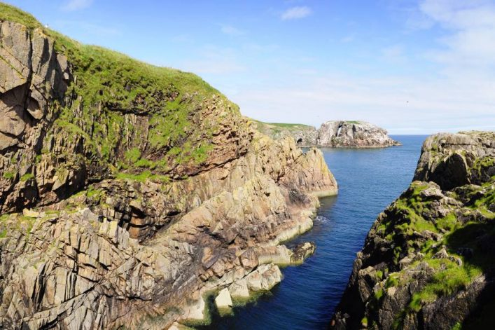 shutterstock_384592744_Rocks-and-cliffs-of-Mull-Head-Nature-Reserve-Deerness-Orkney-island_900x600