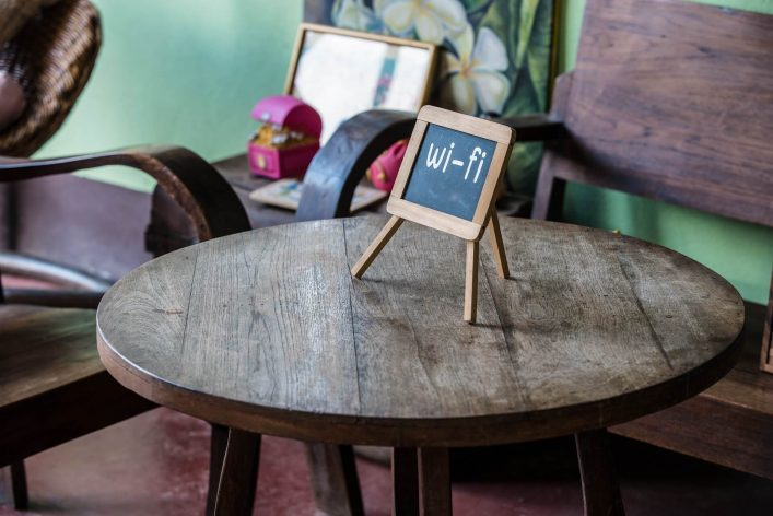 wifi-sign-on-wood-table-in-public-cafe-shutterstock_330475616-2