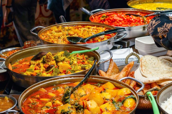 14.-Variety-of-cooked-curries-on-display-at-Camden-Market-in-London_shutterstock_706958239