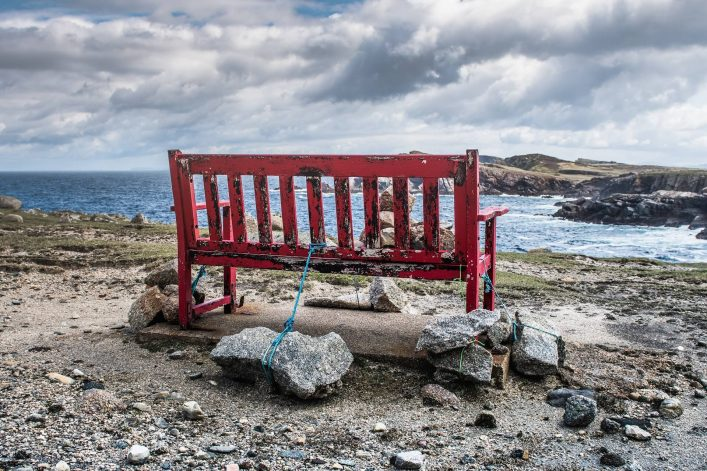 A-viewing-chair-on-Tory-Island.-The-chair-is-weighed-down-by-rocks-to-stop-it-being-blown-away-or-removed-by-any-kind-of-force.-shutterstock_694035058