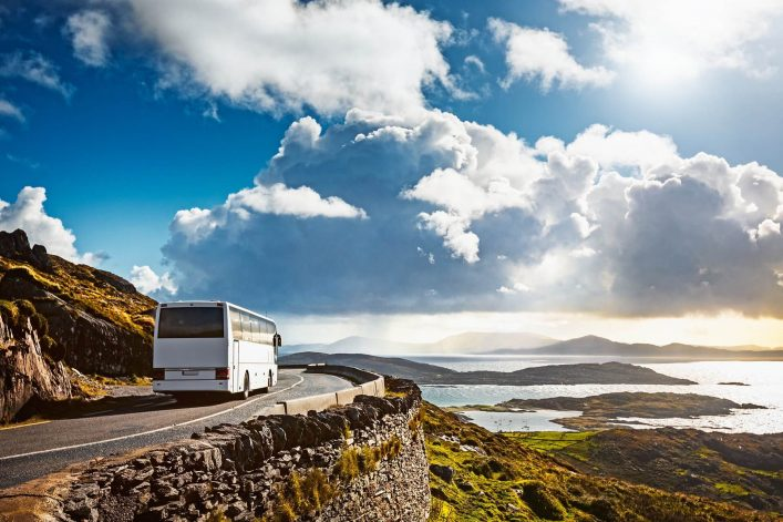 Tourist-bus-traveling-on-mountain-road.-Ring-of-Kerry-Ireland.-Travel-destination.-shutterstock_1151310107