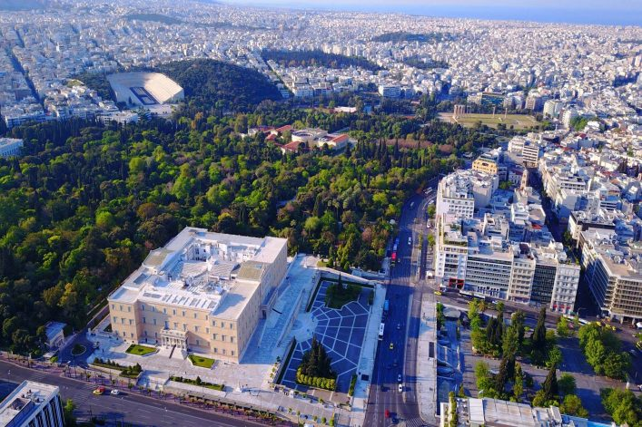 shutterstock_736655896_Aerial-birds-eye-view-photo-taken-by-drone-of-Syntagma-square-and-Greek-Parliament-Athens-Attica-Greece_1920x1280_tiny