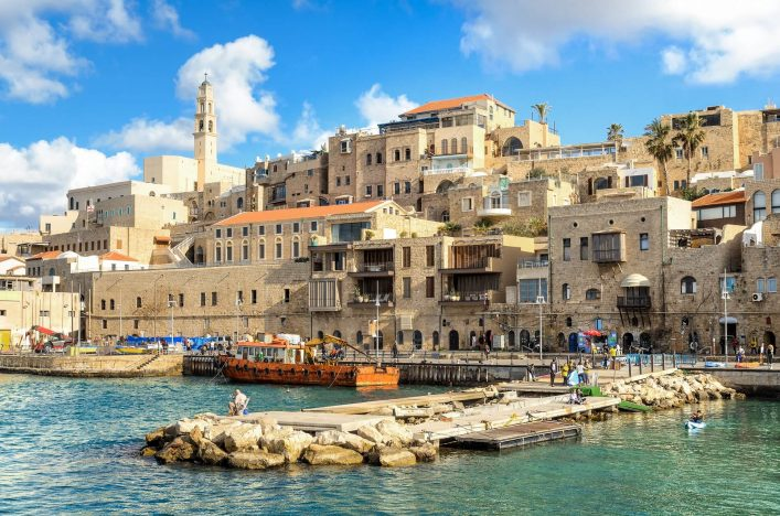A-picturesque-view-to-Jaffa-old-city-and-an-ancient-harbor-on-a-beautiful-day.-Tel-Aviv-Israel.-shutterstock_596047562