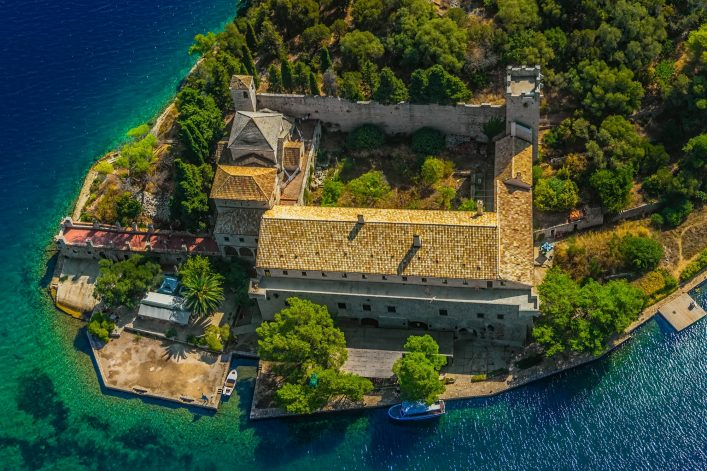Aerial-helicopter-photo-of-Saint-Mary-monastery-on-litle-island-in-national-park-Mljet-Croatia-shutterstock_115428340-2