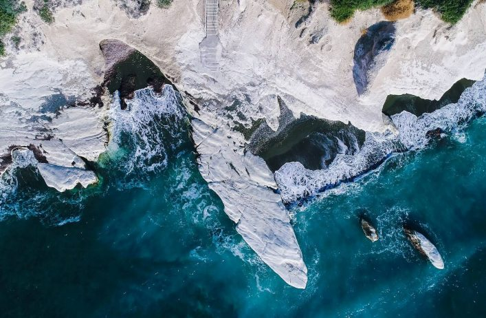 Aerial-view-of-landmark-big-white-chalk-rock-at-Governors-beach-caves-Limassol-Cyprus-shutterstock_790667035-e1534229227912