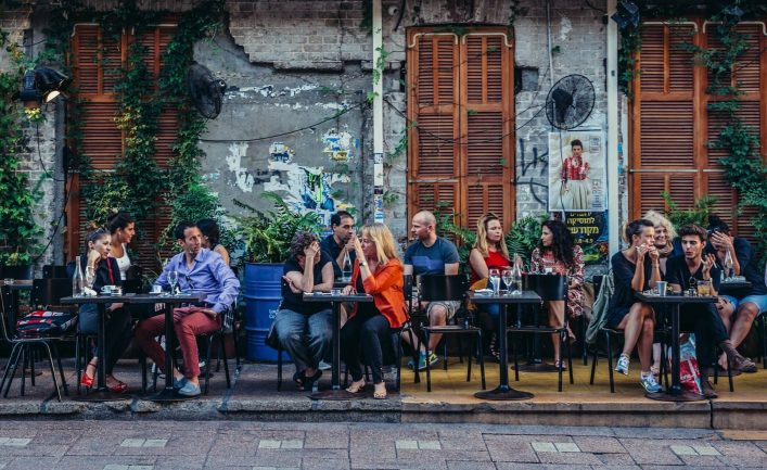 EDITORIAL-ONLY-Fotokon-People-sits-at-tables-outside-the-restaurant-at-Rothschild-Boulevard-in-Tel-Aviv-shutterstock_451641712-e1534401095528