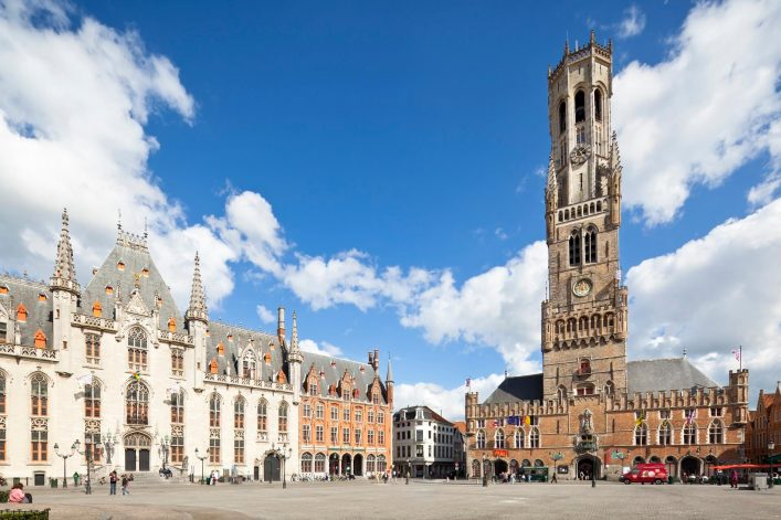 EDITORIAL-ONLY-MichaelUtech-Belfry-and-market-place-in-Bruges-Belgium-in-summer-iStock-458678767
